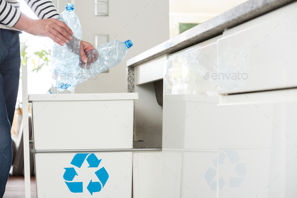 Person throwing plastic bottles - Stock Photo - Images