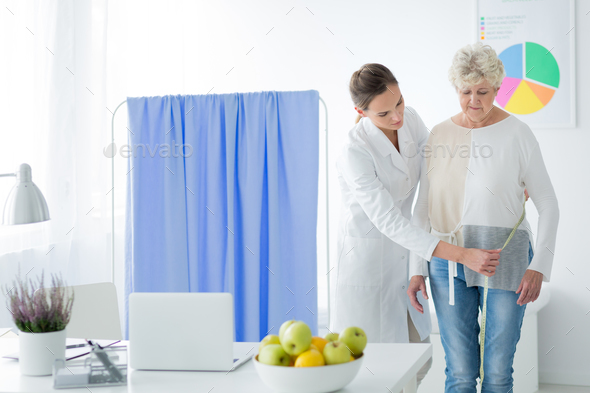 Dietician measuring woman's body circuit - Stock Photo - Images
