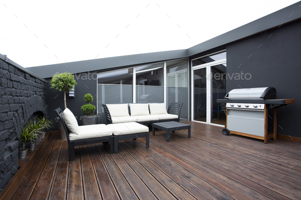 Grill on terrace with plants - Stock Photo - Images