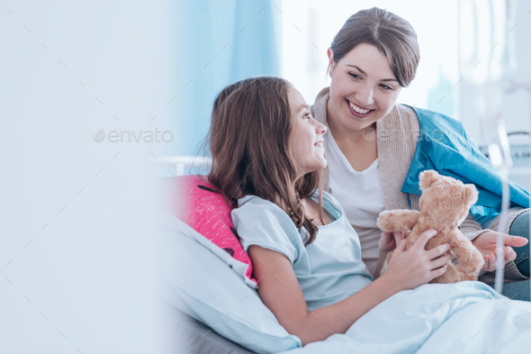 Sisters smiling in hospital - Stock Photo - Images