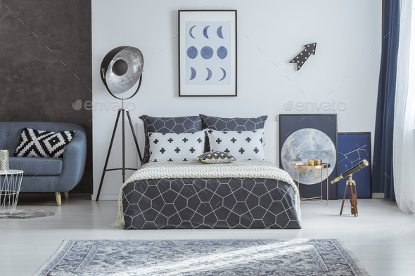 Spacious blue bedroom with telescope - Stock Photo - Images