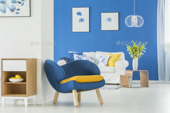 Yellow accents in blue room - Stock Photo - Images