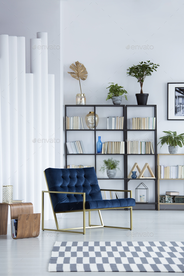 Blue armchair in living room - Stock Photo - Images