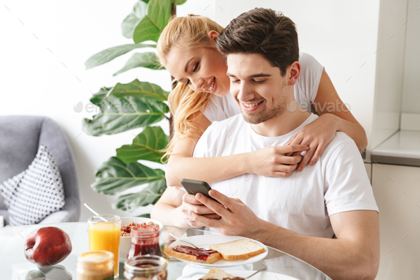Portrait of a happy young couple in love - Stock Photo - Images