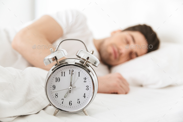 Close up smiling young man sleeping - Stock Photo - Images