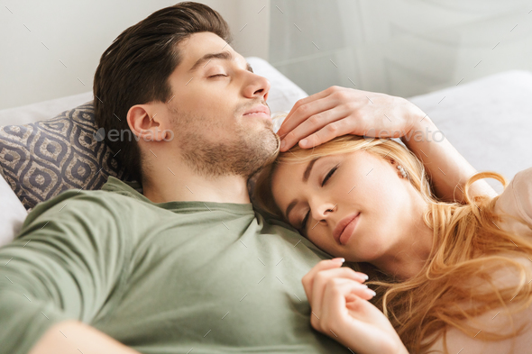 Cute young loving couple sleeping on sofa - Stock Photo - Images
