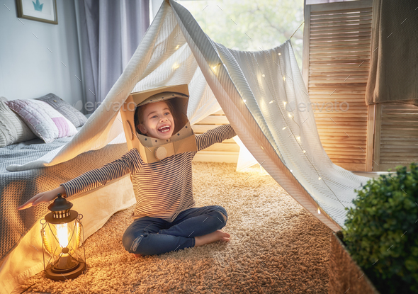 kid playing in tent - Stock Photo - Images