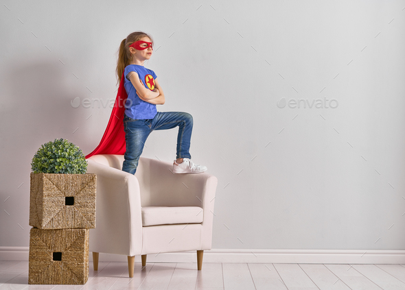 child is playing superhero - Stock Photo - Images