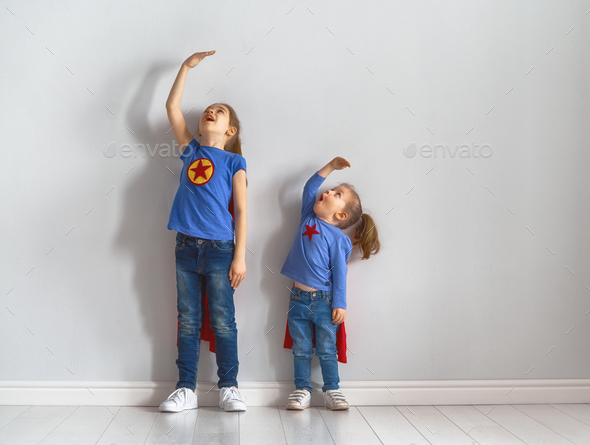 children are playing superhero - Stock Photo - Images