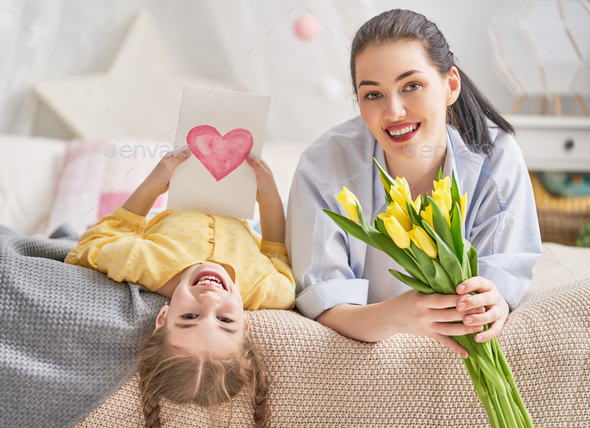 daughter is congratulating mom - Stock Photo - Images