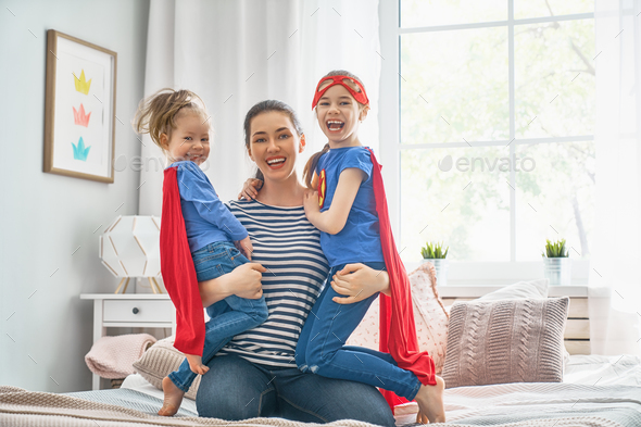 Mother and her children playing together - Stock Photo - Images