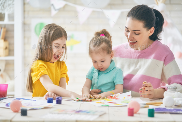 Mother and daughters painting together - Stock Photo - Images