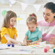 Mother and daughters painting together - PhotoDune Item for Sale