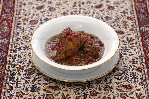 chicken fesenjan, pomegranate walnut stew, iranian persian cuisine - Stock Photo - Images