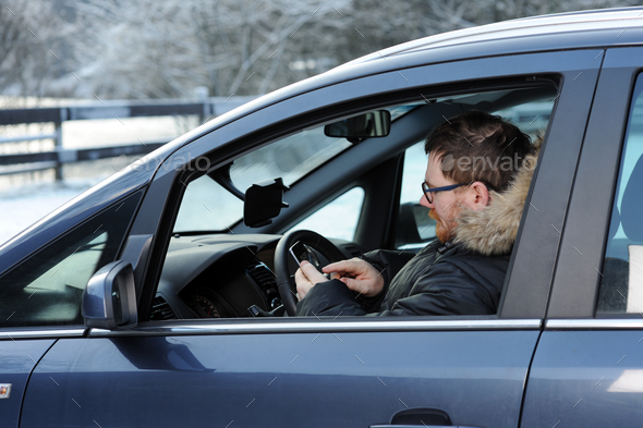 man in the car with telephone - Stock Photo - Images