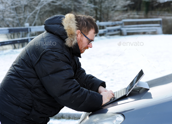 man using tablet on the car - Stock Photo - Images