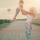 Happy Mother and Little Girl in Her Arms Toss at Sunset - VideoHive Item for Sale