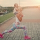 Mom Is Engaged in Sports Squats with the Child - VideoHive Item for Sale