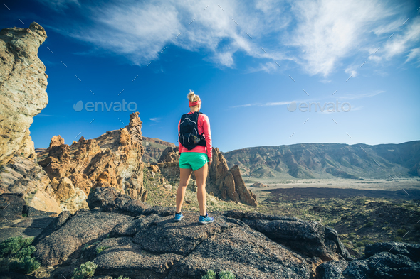 Woman hiker reached mountain top, backpacker adventure - Stock Photo - Images