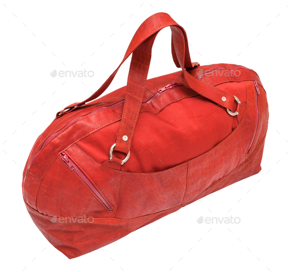 side view of closed red travel bag isolated - Stock Photo - Images