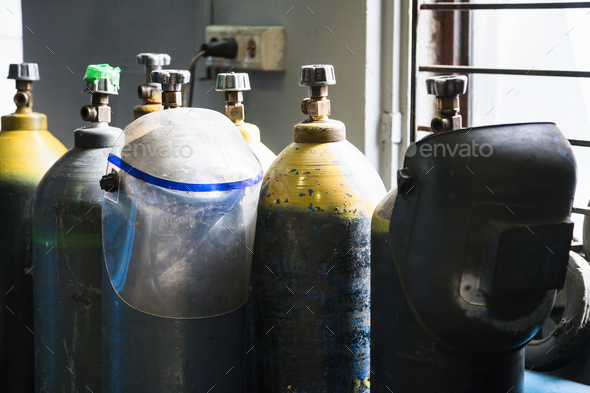 gas cylinders and protection mask in workshop - Stock Photo - Images