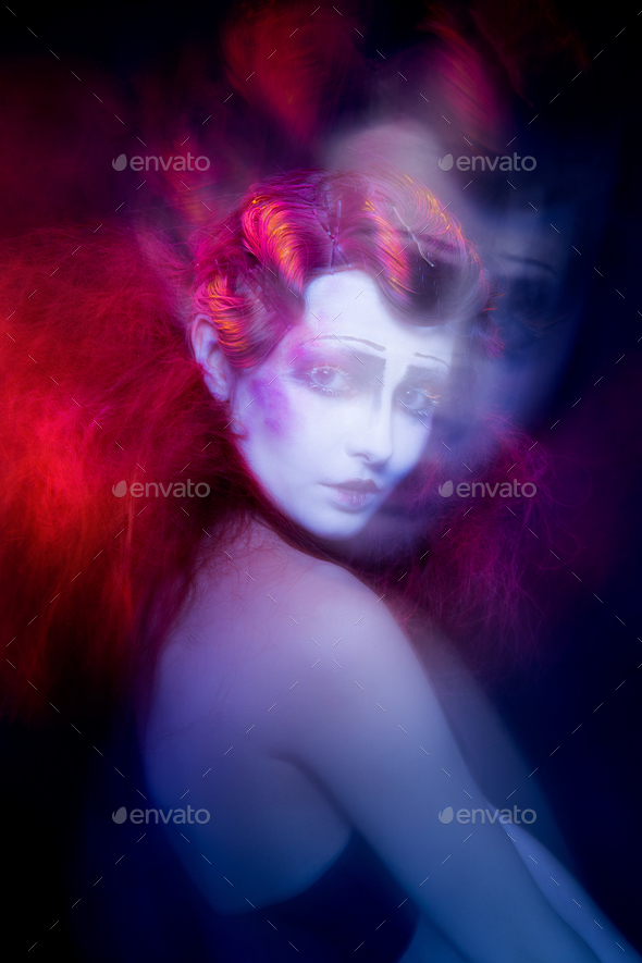 High Fashion model woman in colorful bright lights posing in studio - Stock Photo - Images