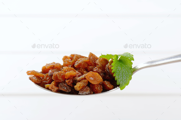 spoon of sweet raisins - Stock Photo - Images