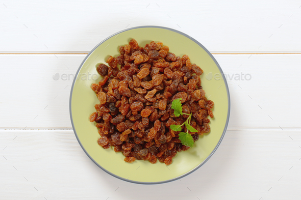 plate of sweet raisins - Stock Photo - Images