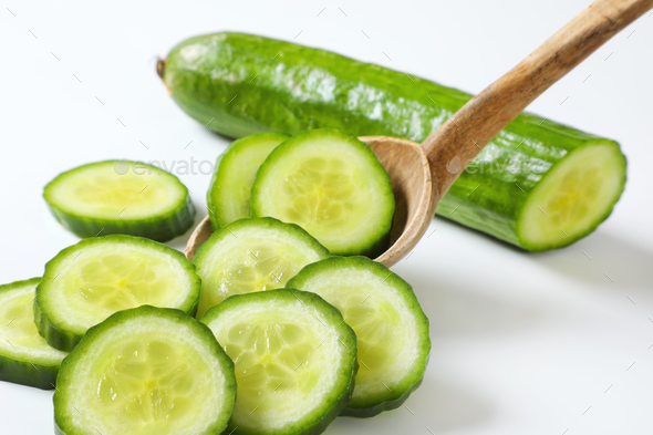 slices of green cucumber - Stock Photo - Images