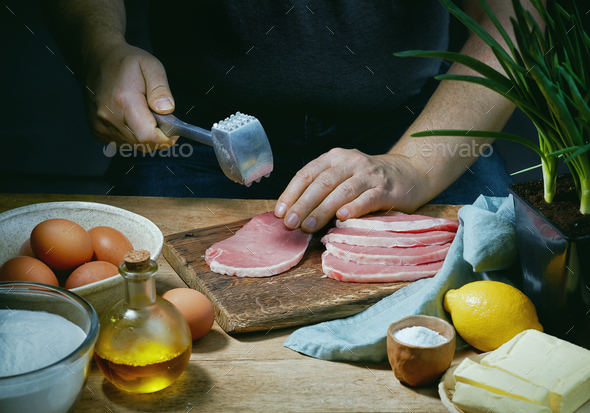 cook is preparing meat - Stock Photo - Images