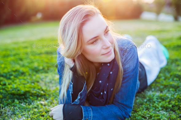 Beautiful woman relaxing outdoors - Stock Photo - Images