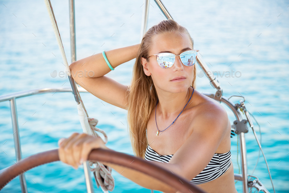 Attractive girl on sailboat - Stock Photo - Images