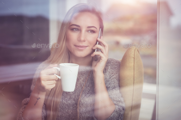 Pretty woman talking on the phone - Stock Photo - Images