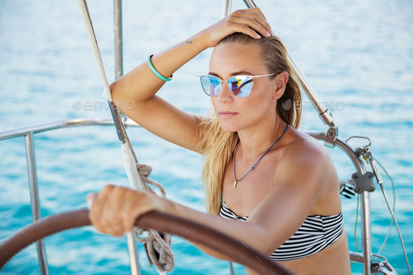 Beautiful woman on sailboat - Stock Photo - Images