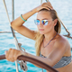 Beautiful woman on sailboat - PhotoDune Item for Sale