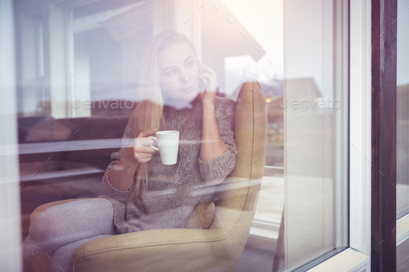 On the phone with cup of tea - Stock Photo - Images