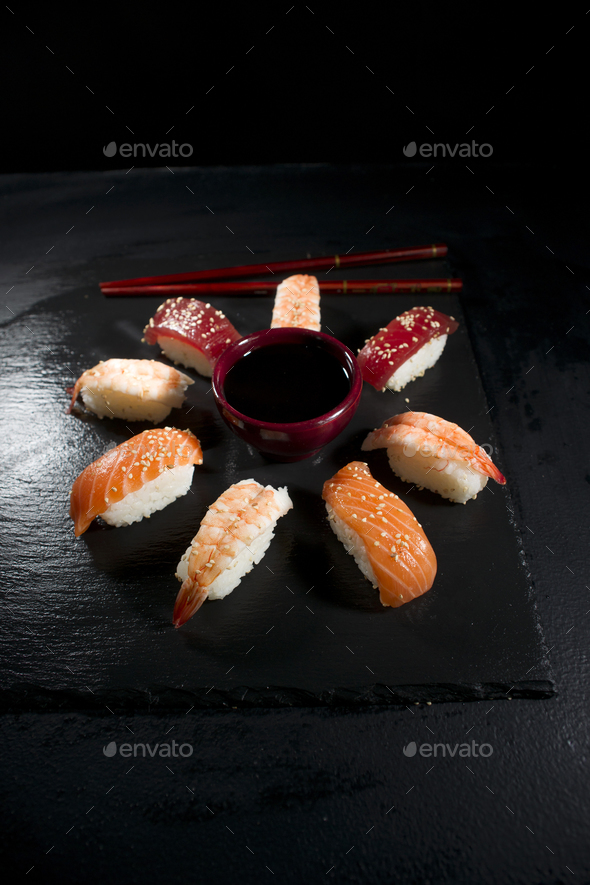 Circular sushi plate with chopsticks - Stock Photo - Images