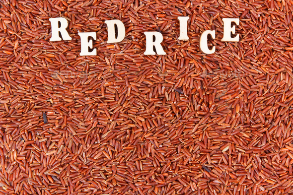 Heap of red rice, healthy, gluten free nutrition concept, copy space for text - Stock Photo - Images
