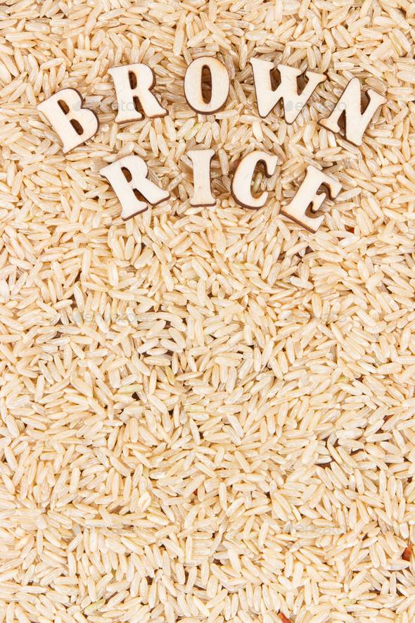 Heap of brown rice as background, healthy gluten free food concept, copy space for text - Stock Photo - Images