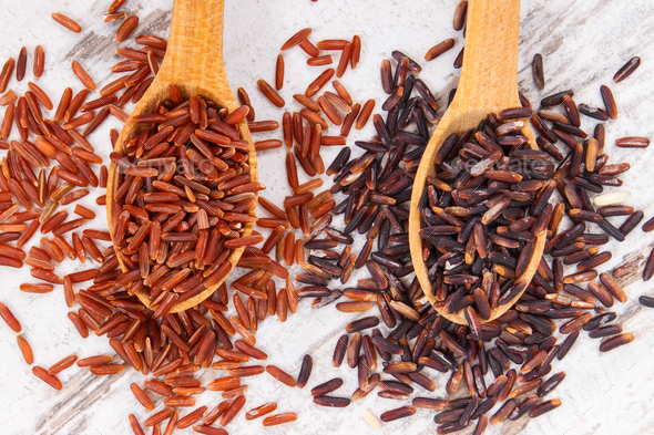 Black and red rice on spoons, healthy, gluten free nutrition concept - Stock Photo - Images