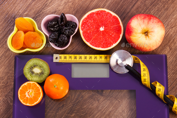 Electronic bathroom scale, centimeter and stethoscope, healthy food and lifestyles concept - Stock Photo - Images