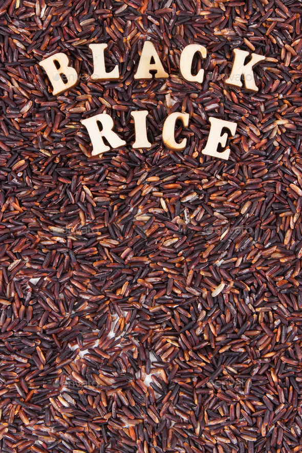 Heap of black rice as background, healthy gluten free food concept, copy space for text - Stock Photo - Images