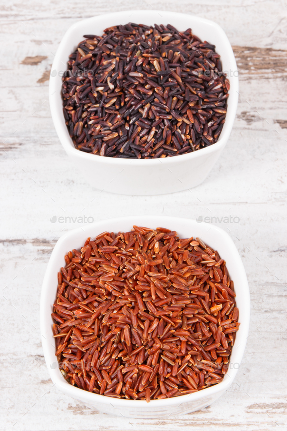 Red and black rice in glass bowls, healthy nutrition concept - Stock Photo - Images