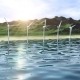 Wind Generators Farm in Ocean Near an Island Loop - VideoHive Item for Sale