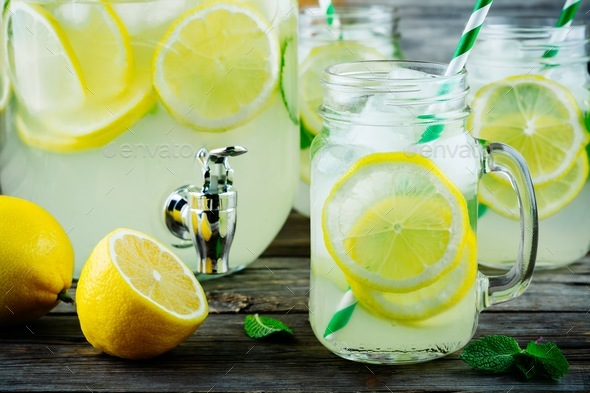 Homemade lemonade with mint, ice, and fresh lemon slices in mason jar - Stock Photo - Images