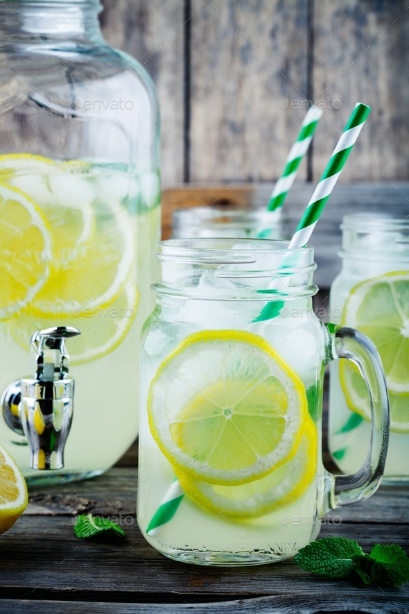 Homemade lemonade with mint, ice, and fresh lemon slices in mason jar - Stock Photo - Images