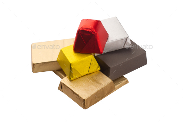 closeup of chocolate bars in shiny packaging foil - Stock Photo - Images