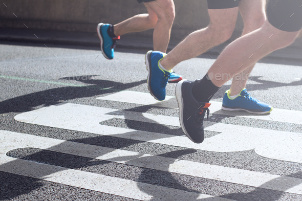 synchronized legs of marathon runners - Stock Photo - Images
