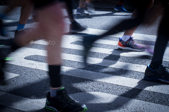 closeup on marathon runners legs and feet with motion blur - Stock Photo - Images