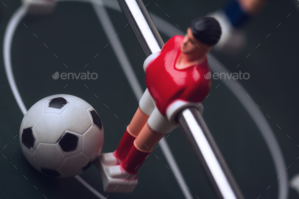 closeup of football figurine on foosball table soccer game - Stock Photo - Images